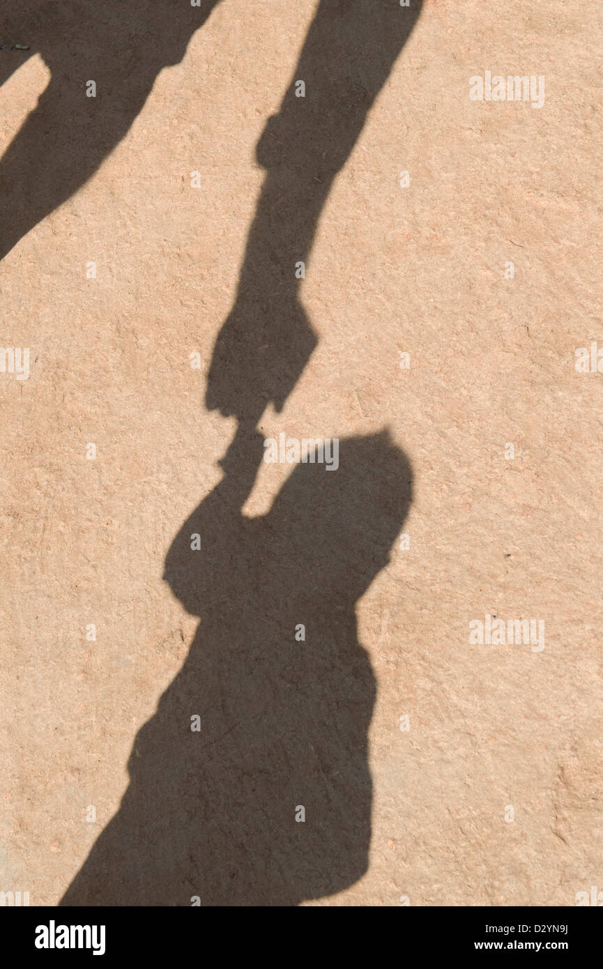 Father playing with son shadow. India Stock Photo