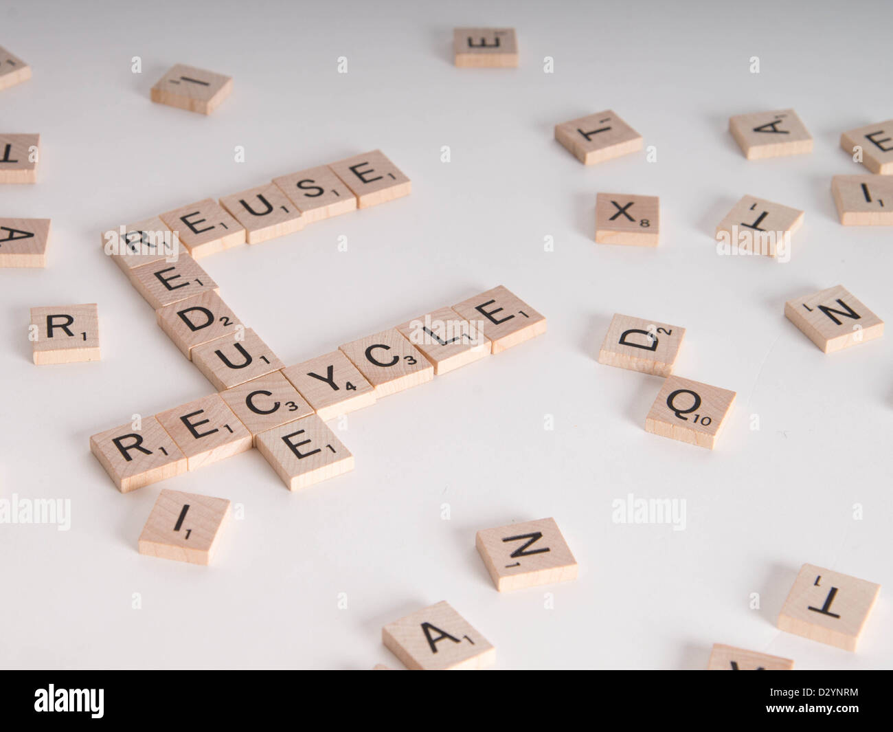Reduce, Reuse, Recycle concept. Wooden Scrabble letters spell out 'reduce, reuse, recycle' Isolated on white - Stock Image