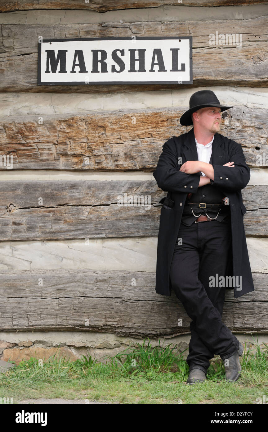 Marshal in the old American west standing watch, authentic reenactor portrayal of sheriff Wyatt Earp - Stock Image