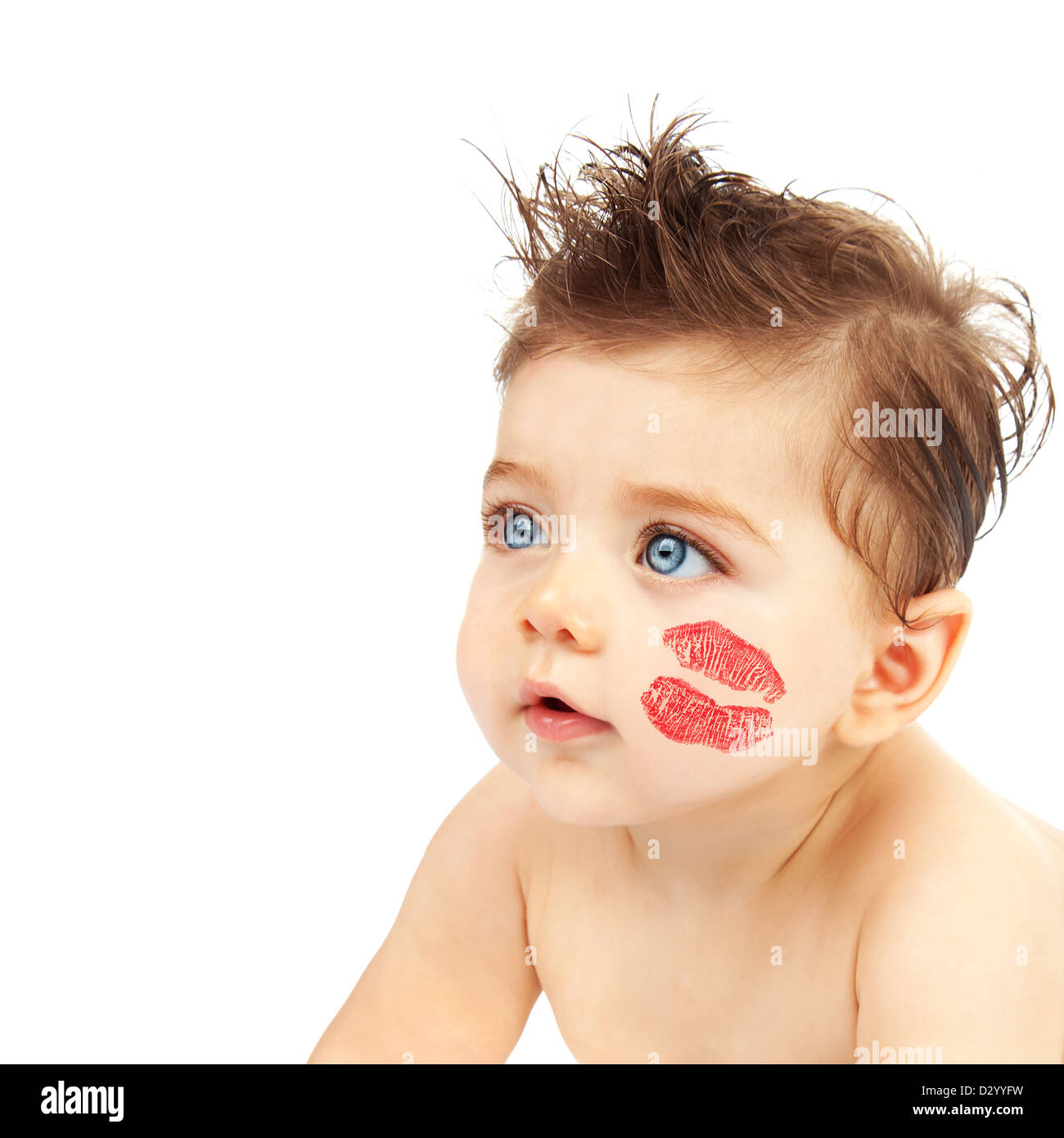 1179a9807 Photo of cute baby boy with red kiss on the cheek