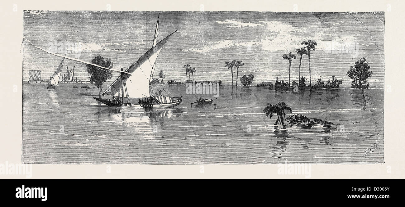 VIEW BELOW KAFR ZAYAT SHOWING THE RAILWAY BRIDGE AND TRAIN OFF THE LINE INUNDATION OF THE NILE - Stock Image