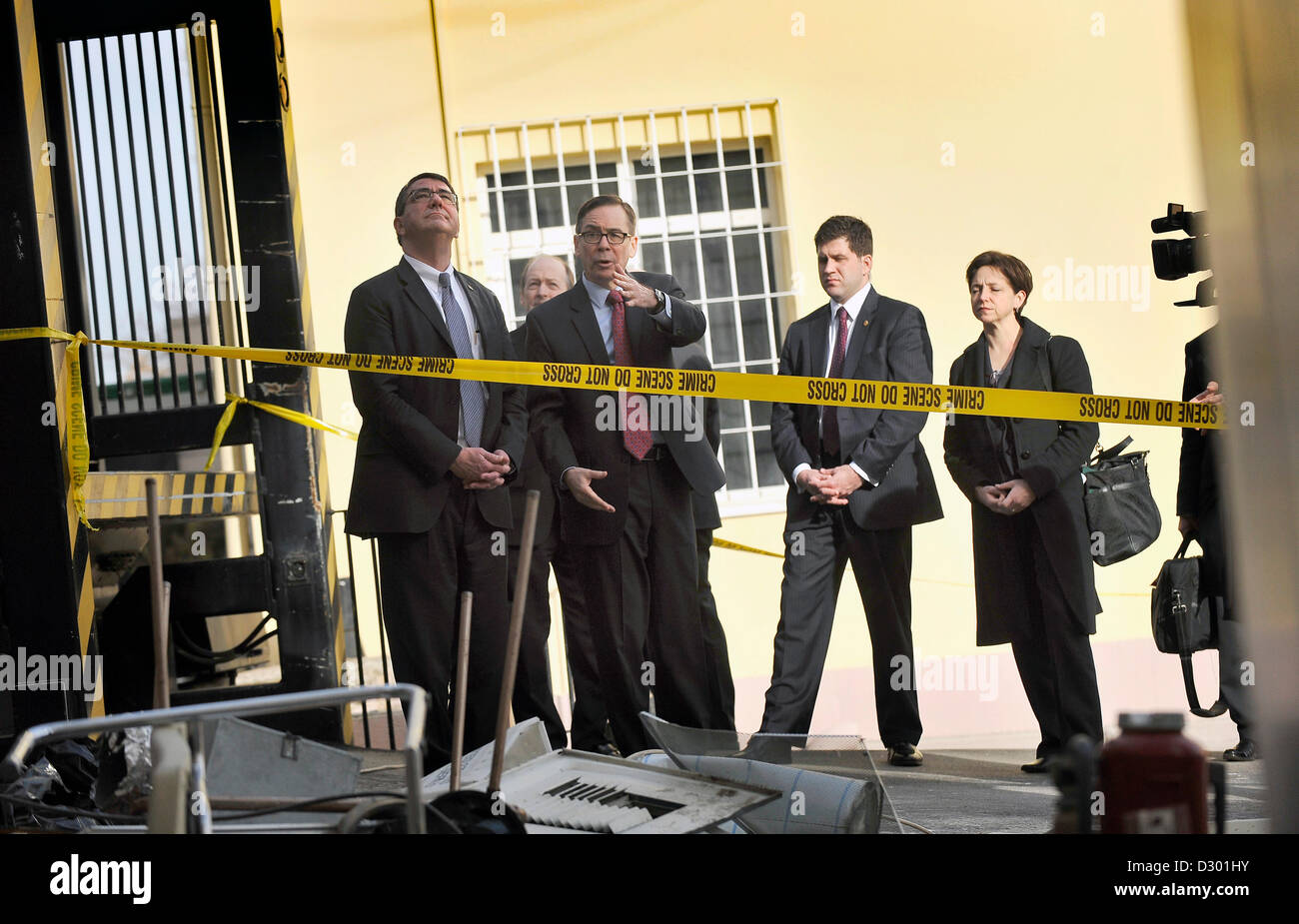 US Deputy Secretary of Defense Ashton Carter (left) accompanied by Jess Baily, Deputy Chief of Mission, views damage - Stock Image