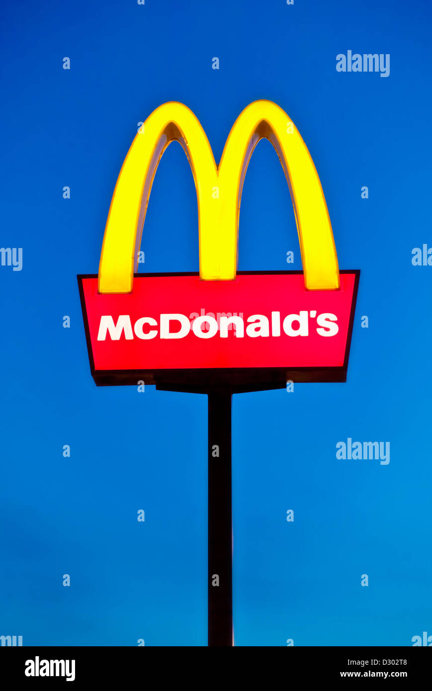 Mcdonald's Logo arches sign against a clear blue sky UK - Stock Image
