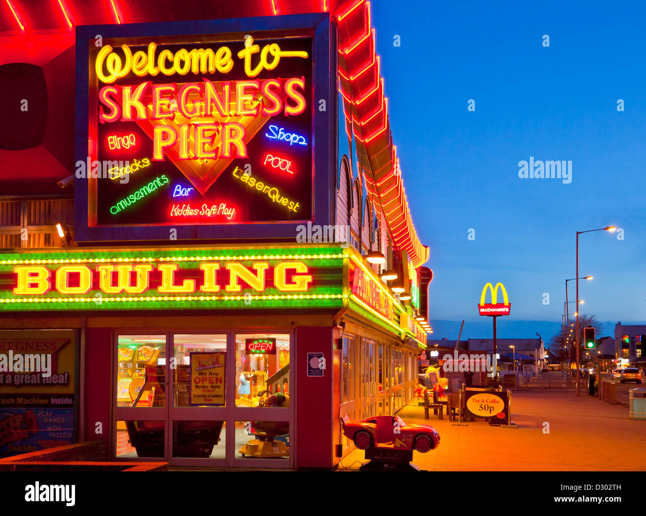 neon signs for bowling, amusements and Skegness Pier at the seafront Lincolnshire England UK GB EU Europe Stock Photo