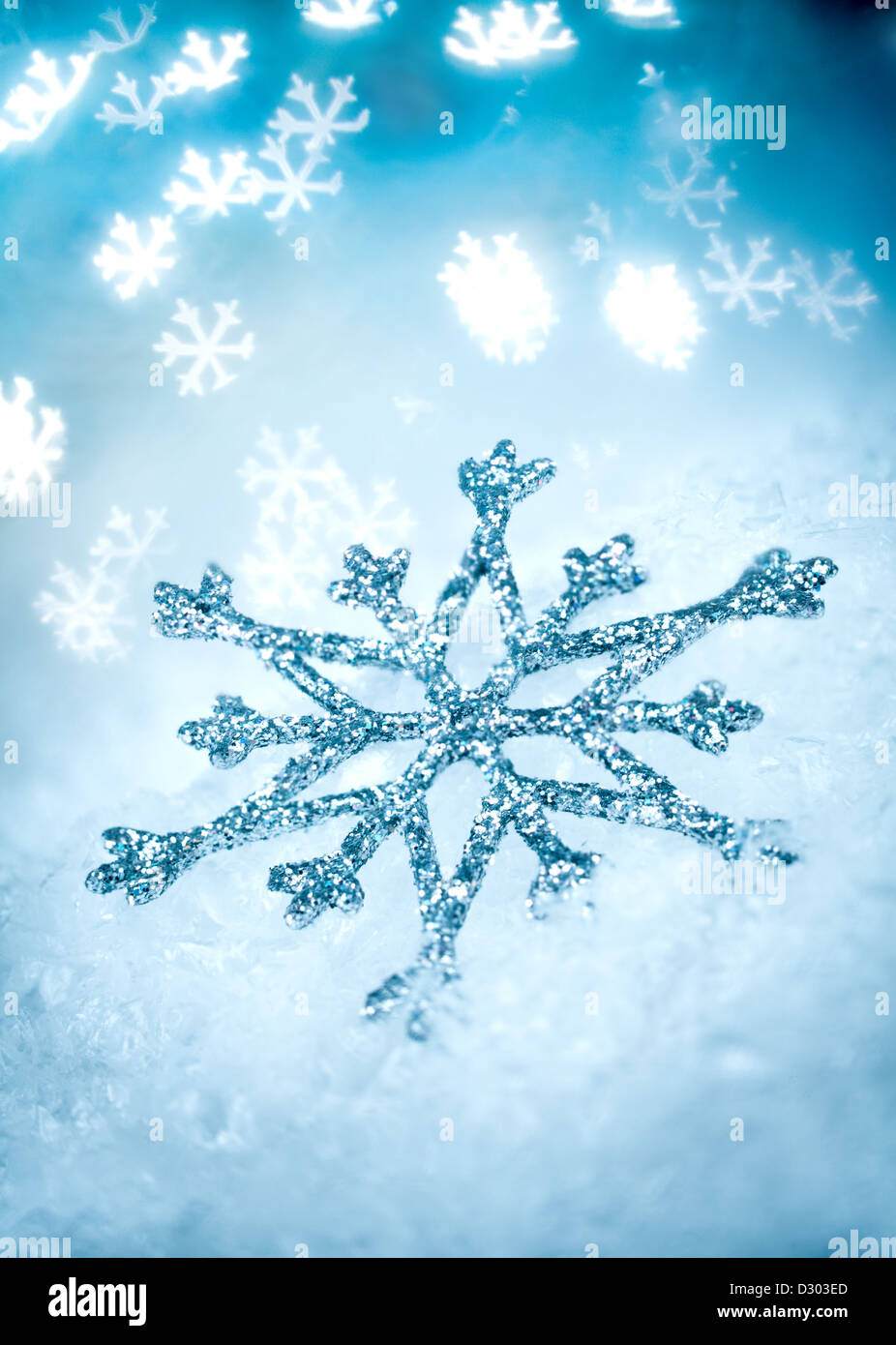 Snowflake on a Blue Holiday background ... Stock Photo