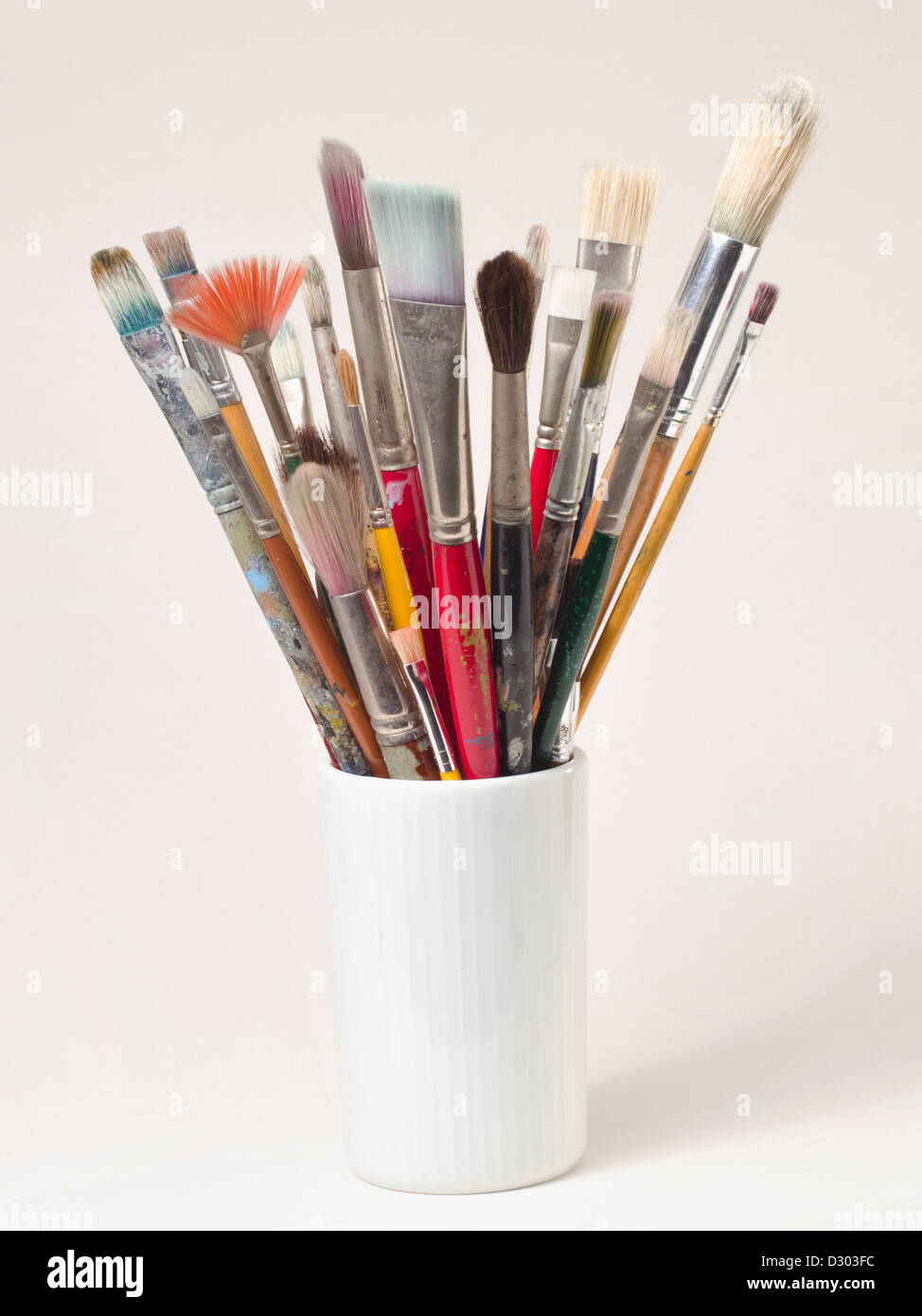 canister of multiple fine art brushes - Stock Image