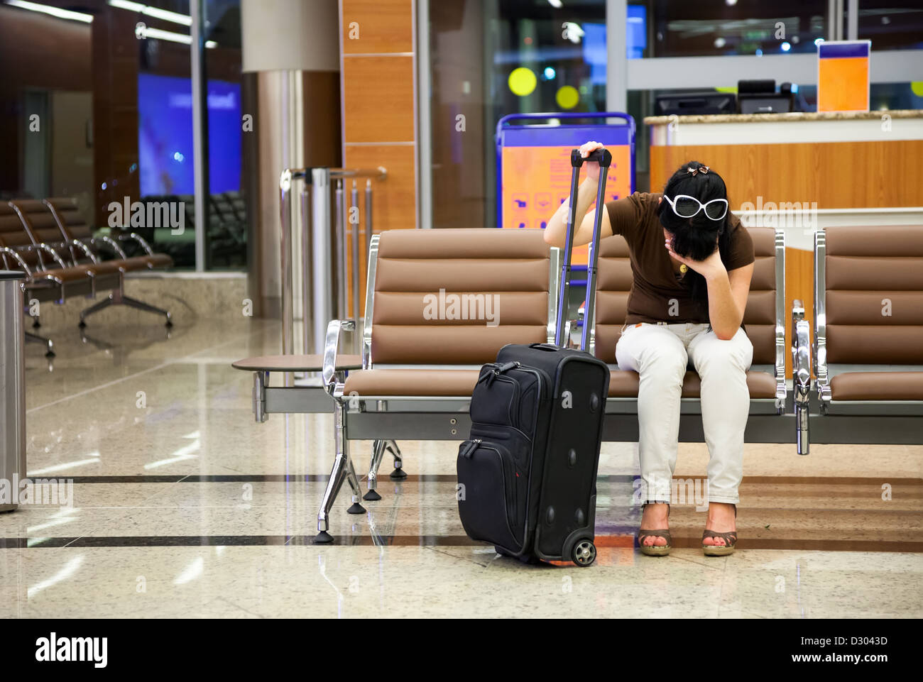 woman was late for a plane at the airport - Stock Image