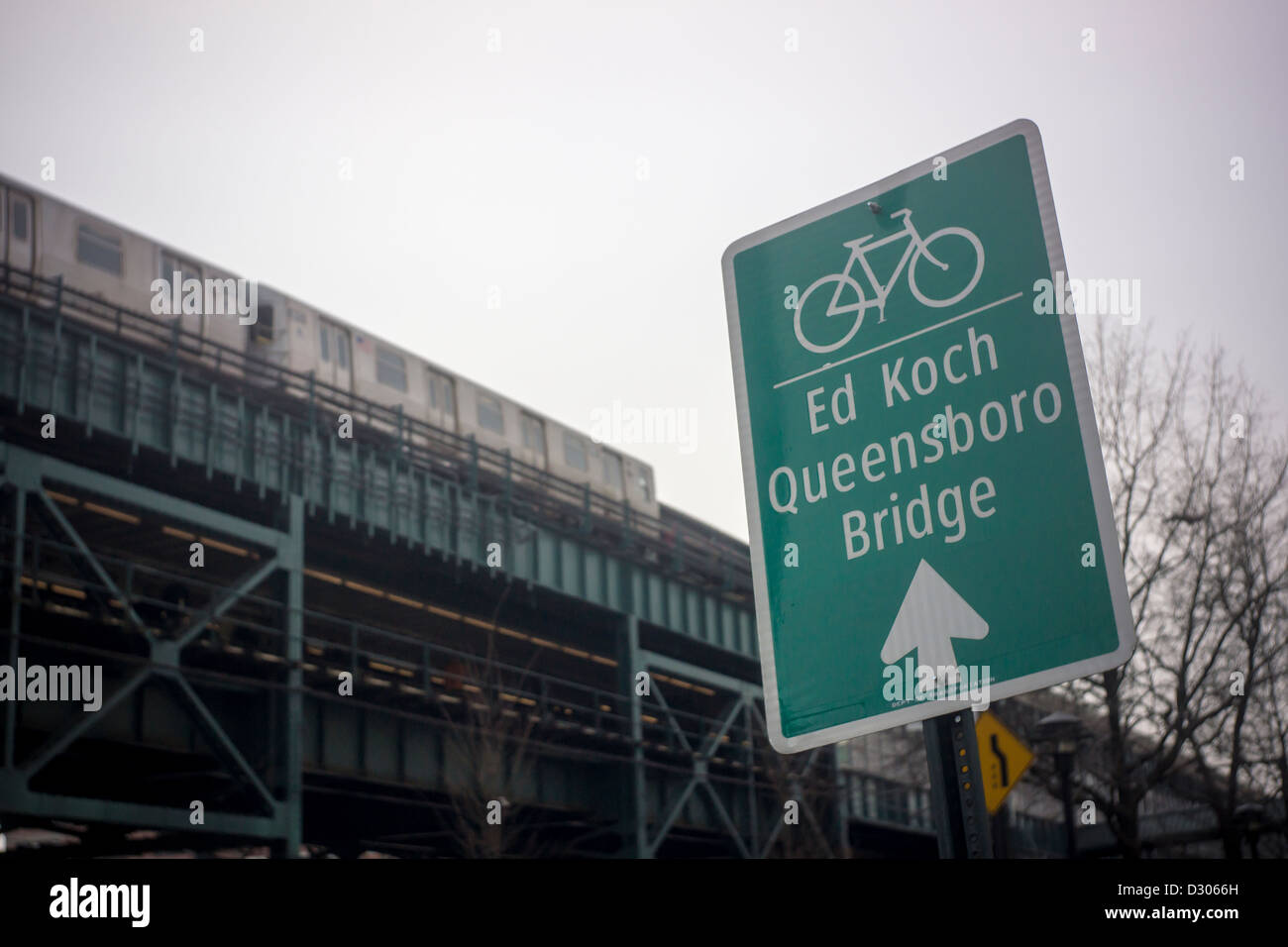 Signage directs bicyclists to the bike lane on the Ed Koch-Queensboro Bridge in Long Island City in Queens in New Stock Photo