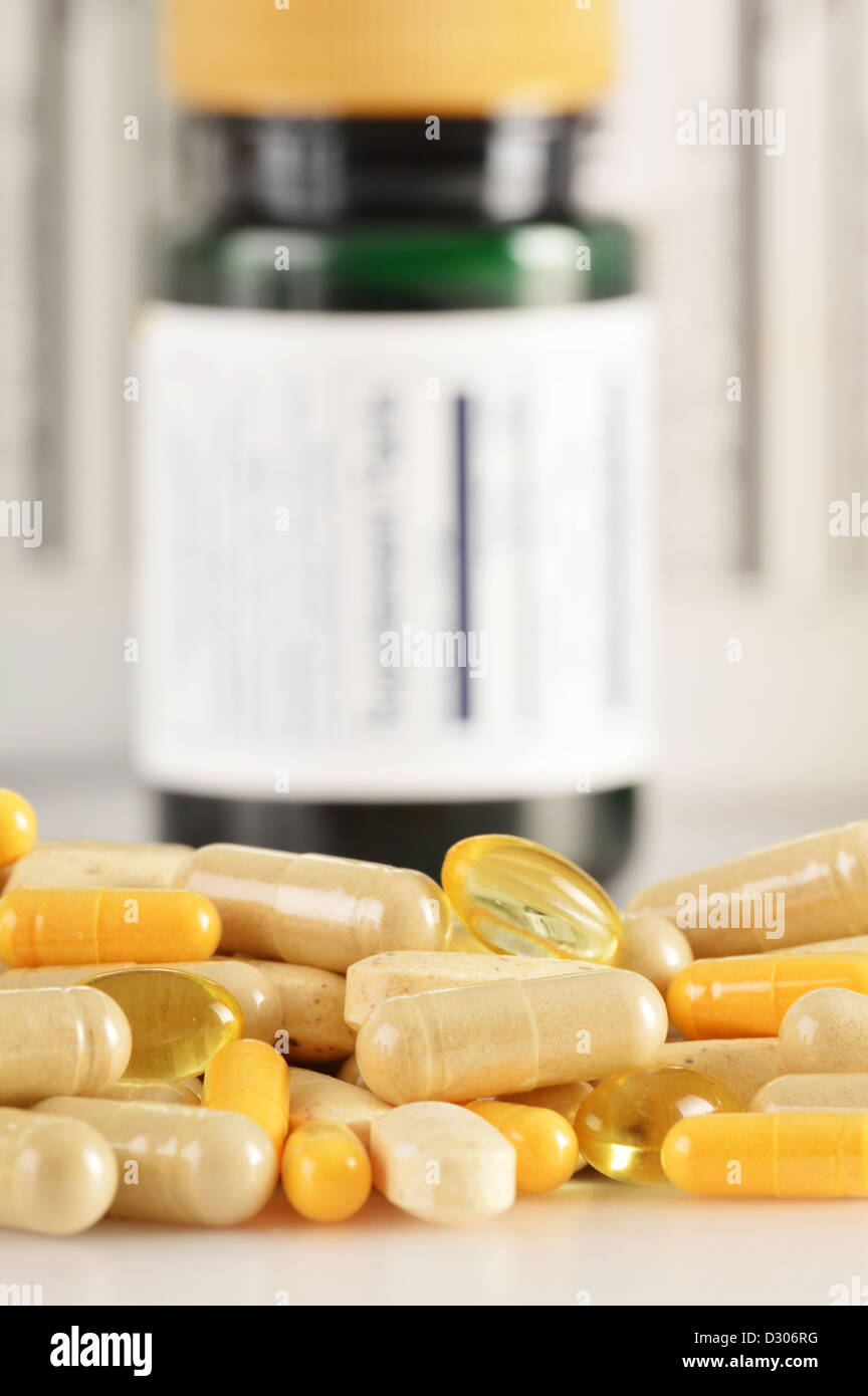 Composition with dietary supplement capsules. Drug pills - Stock Image
