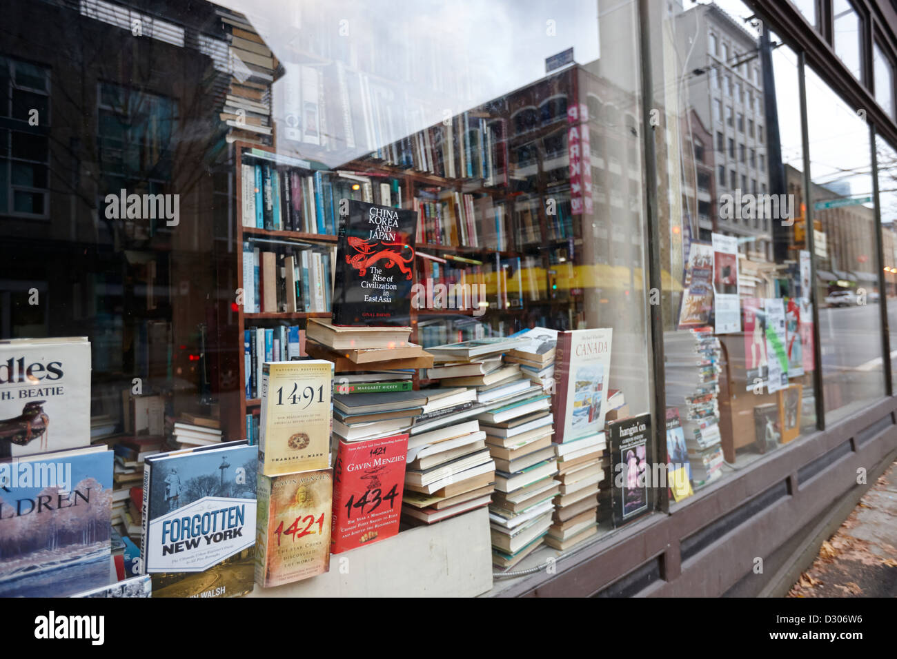 books in the window of a used book store Vancouver BC Canada - Stock Image