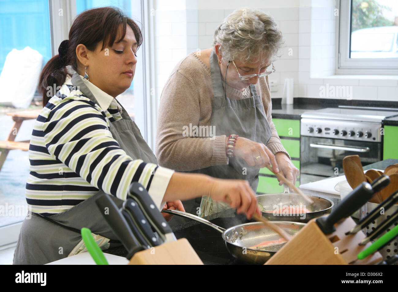 women taking cookery classes in cookery school - Stock Image