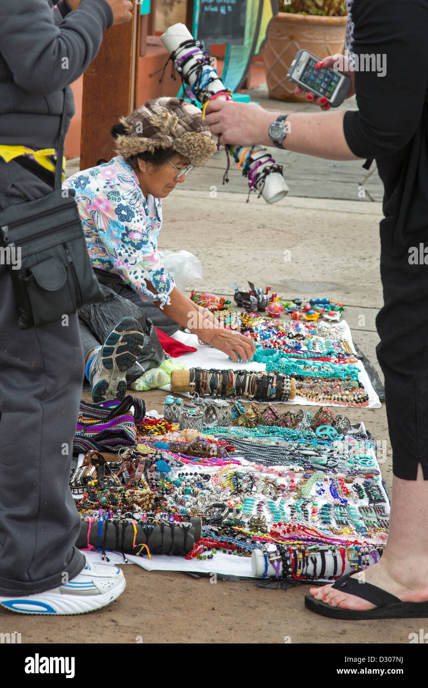 San Diego, California - Street vendors sell jewelry to tourists on the sidewalk at Seaport Village in downtown San - Stock Image