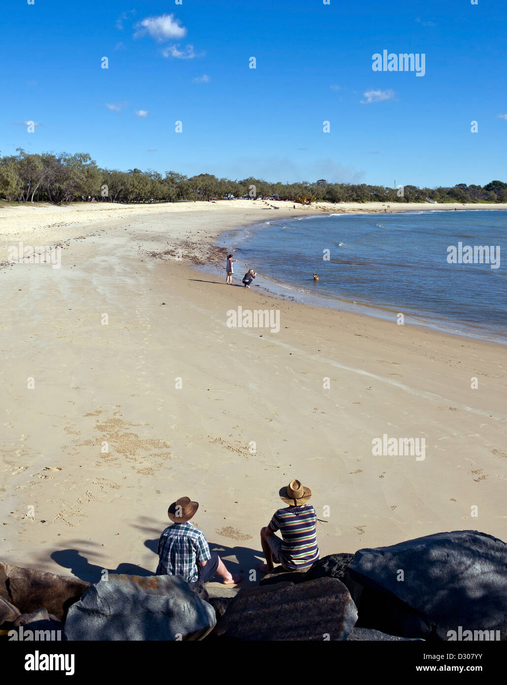 Sunshine Coast in Queensland, Australia - People sitting on Mooloolaba Beach - Stock Image