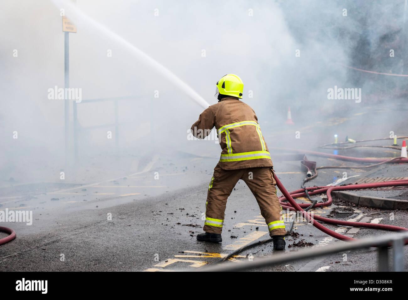 Fireman tackle a blaze in England, UK - Stock Image