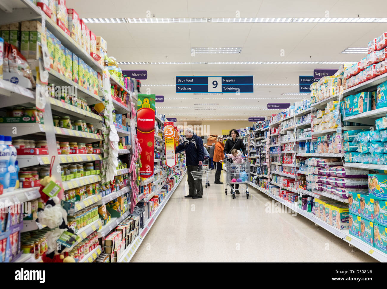 Shoppers in a Tesco supermarket, UK - Stock Image