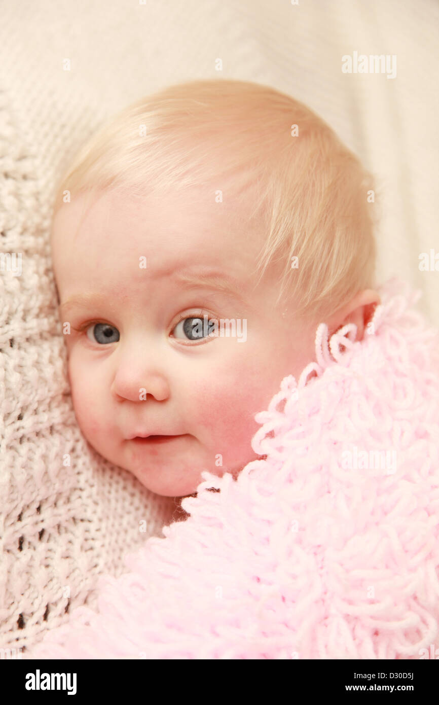 Baby girl with red cheeks - Stock Image