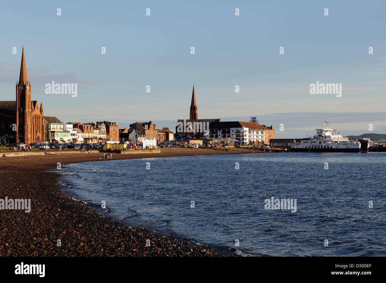 Late evening sunshine over the Firth of Clyde in the town of Largs in Ayrshire, Scotland, UK - Stock Image
