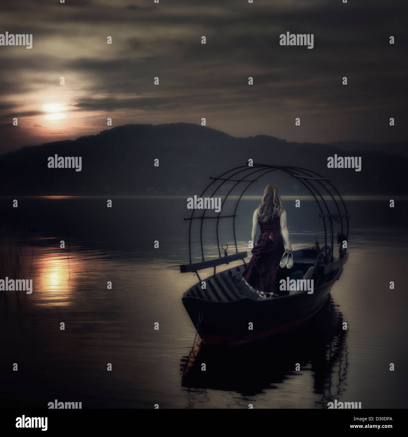 a woman in a red dress on an old fishing boat - Stock Image