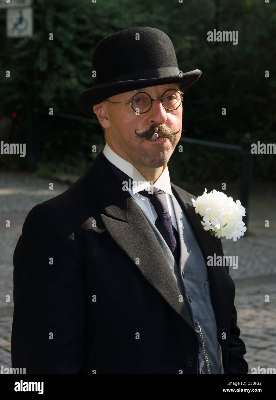 Portrait of a man in a bowler hat. Imperial Holiday (Kaiserfest) - Stock Image