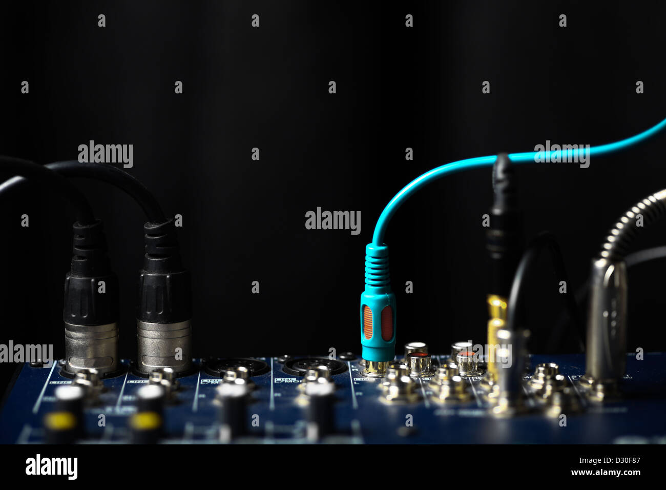 Color shot of many jacks plugged in a mixer Stock Photo
