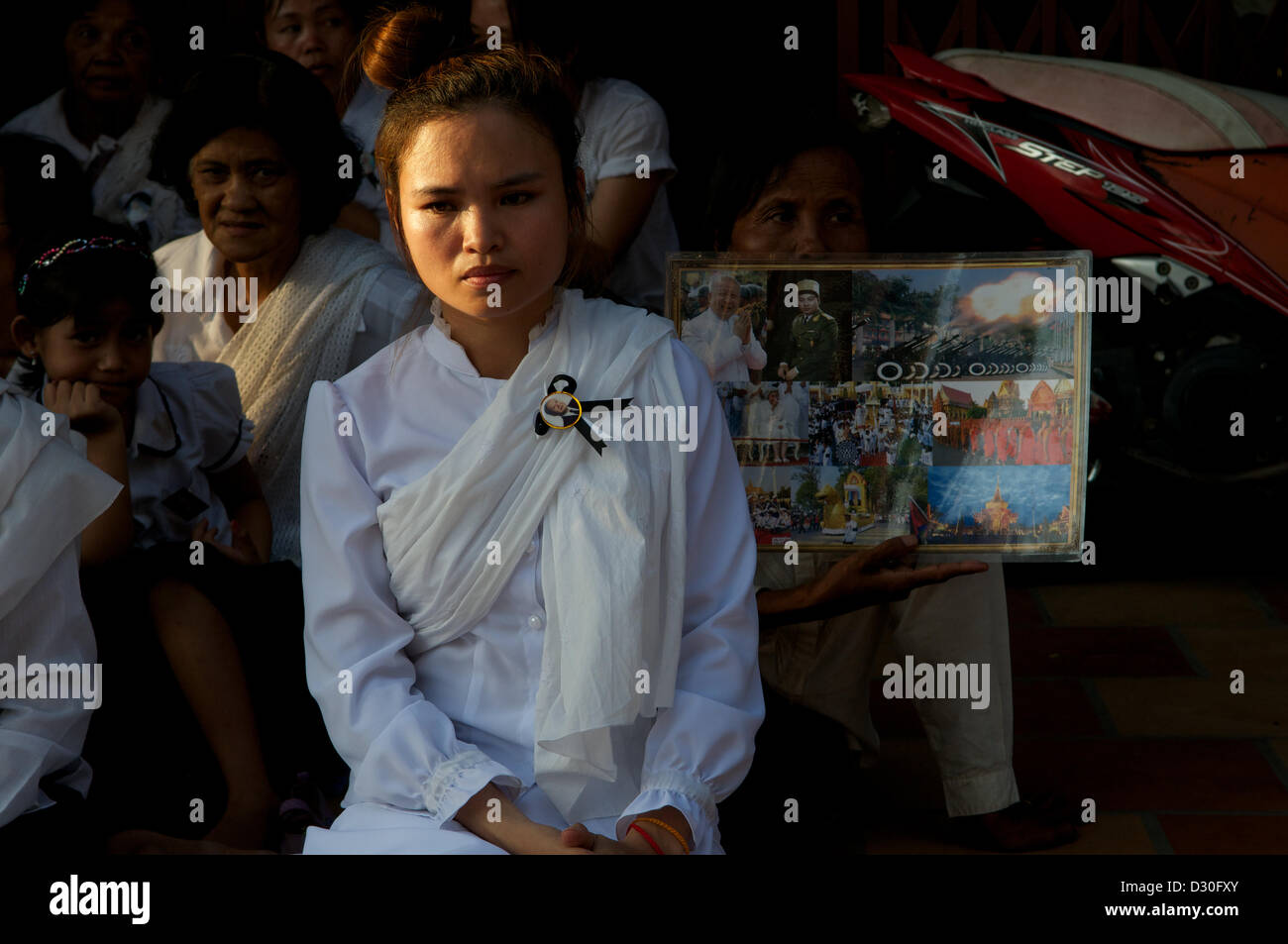 Phnom Penh, Cambodia. 4th February 2013. Portrait of a young Khmer woman mourning, Cambodians mourn the loss of Stock Photo