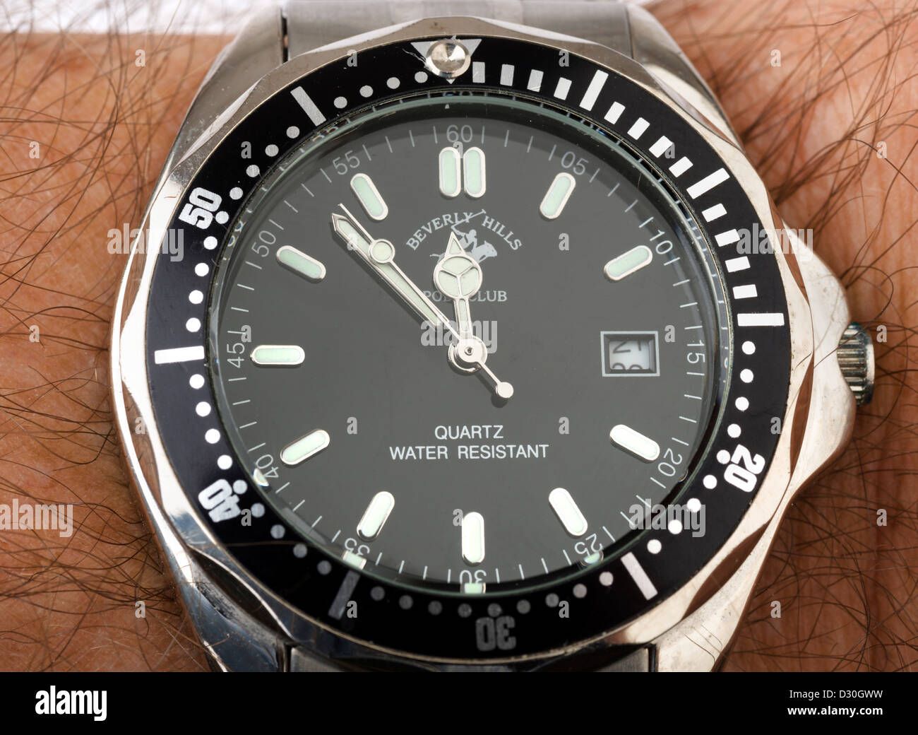 Close-up of a watch on a man's wrist - Stock Image