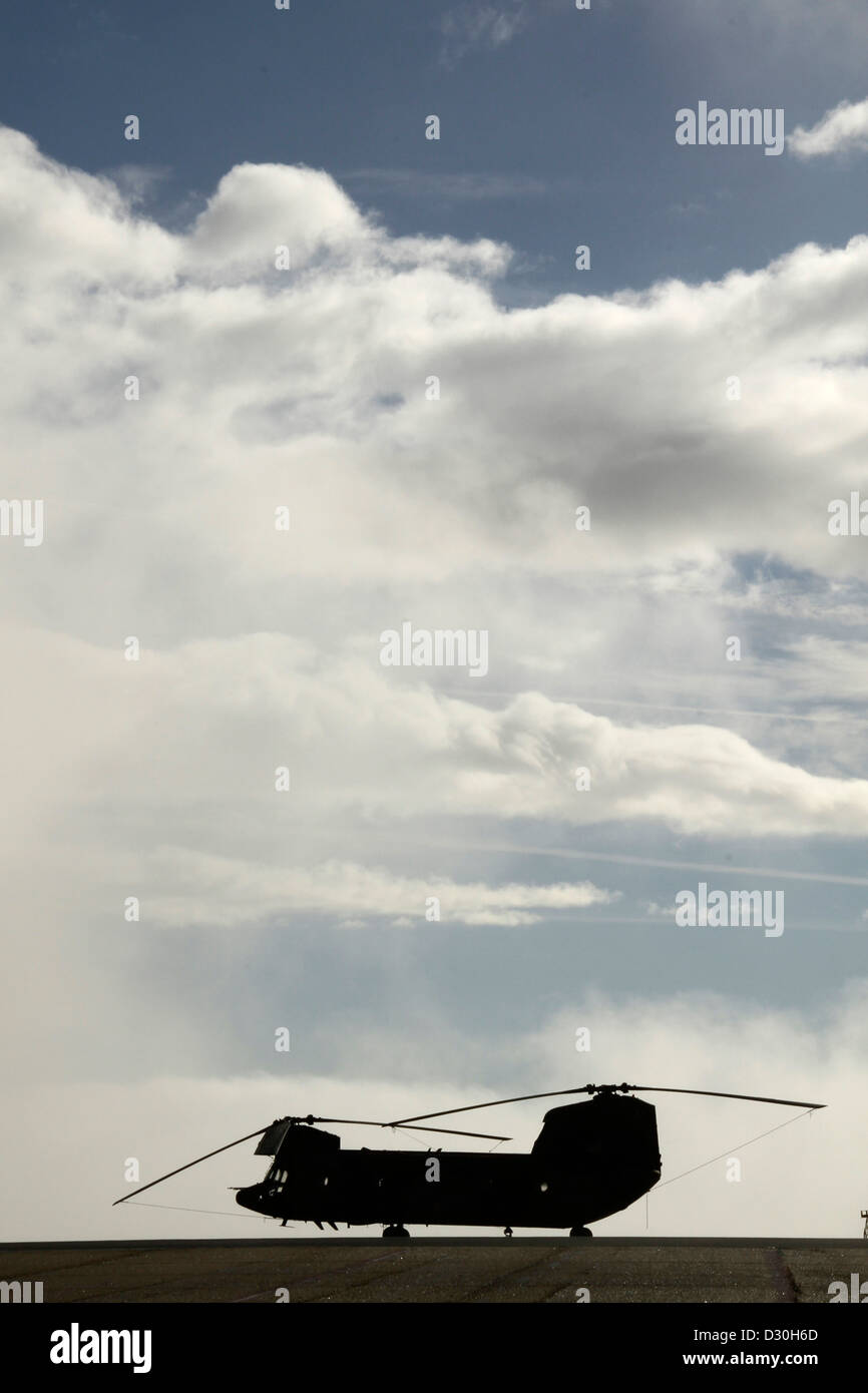 Silhouette of military helicopter transport vehicles - Stock Image