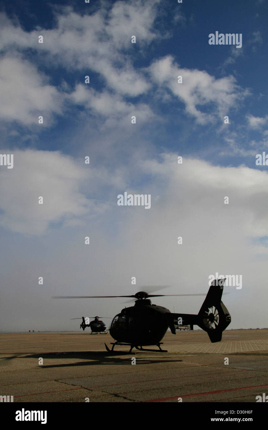 Silhouette of military helicopter - Stock Image