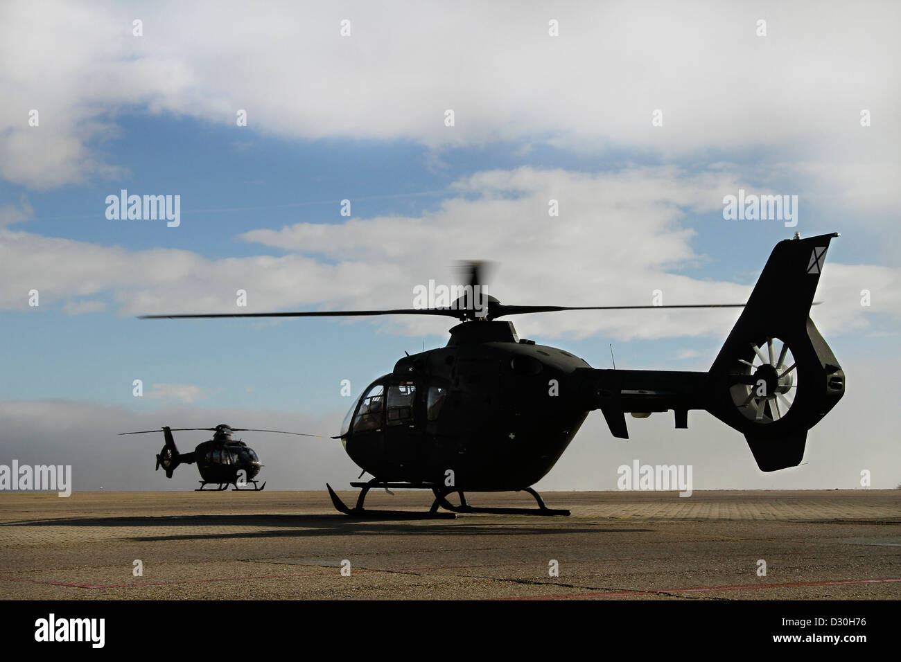 Silhouette of two military helicopter - Stock Image