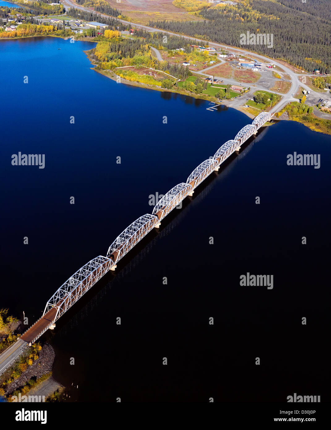 The long Teslin Bridge and the Alaska Highway crossing Nisutlin Bay in the Yukon Territory in Canada. An aerial - Stock Image