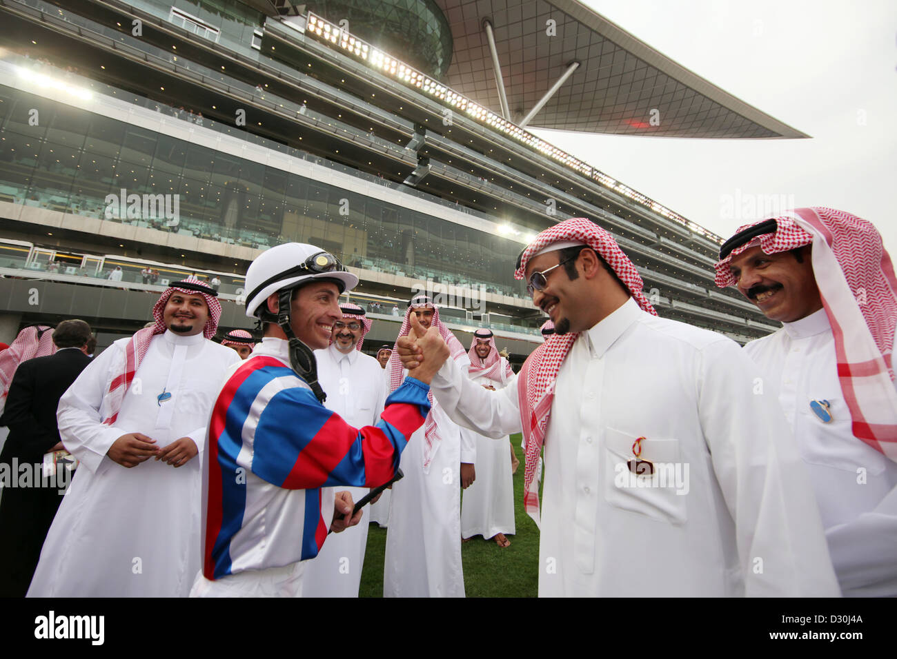 Dubai, United Arab Emirates, a man in jockey welcomed Fuehrring - Stock Image