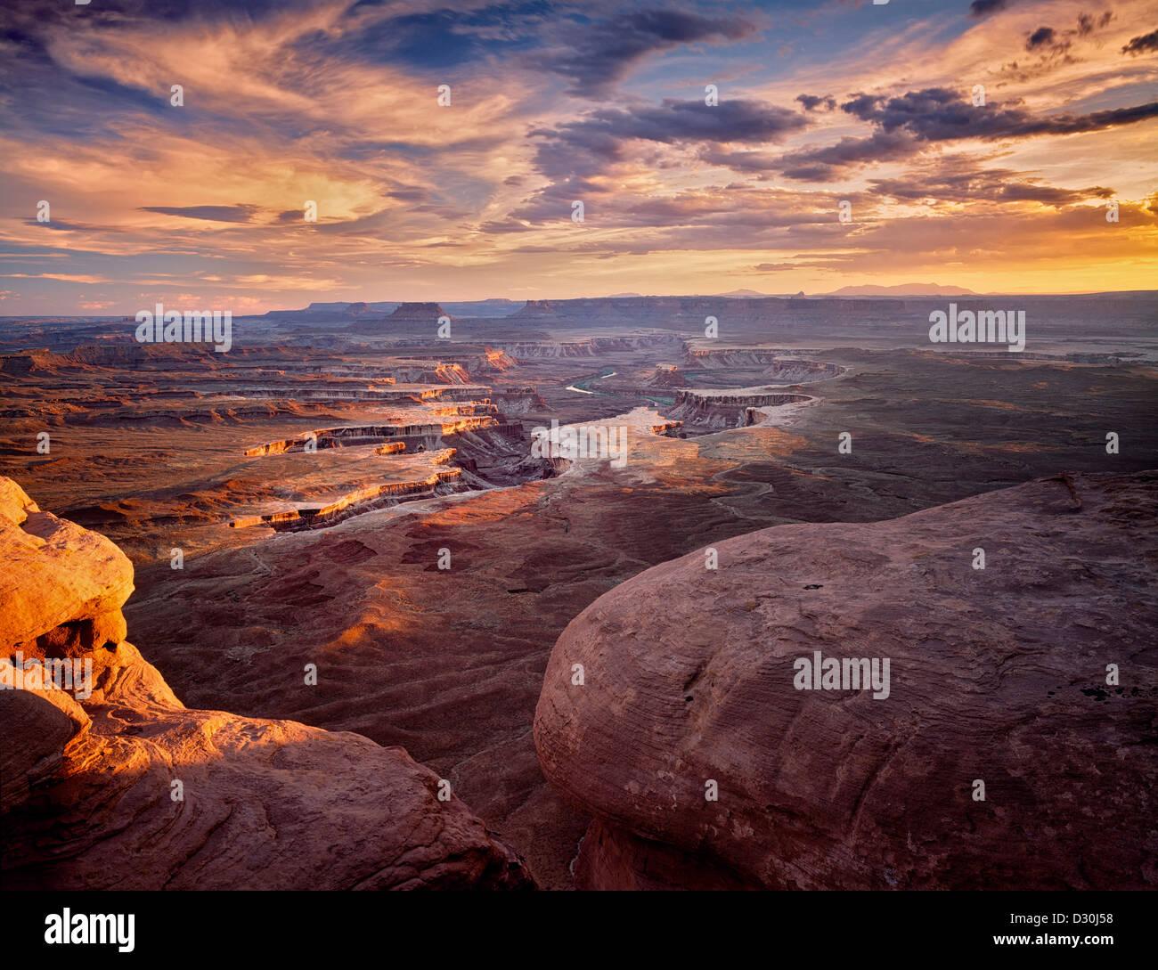 Sun peeking through storm clouds at Green River Overlook. Canyonlands National Park. Utah. - Stock Image