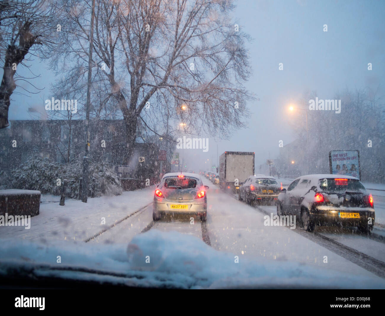 Cars stuck in snow storm during bad weather causing traffic chaos in South Yorkshire England February 2013 - Stock Image