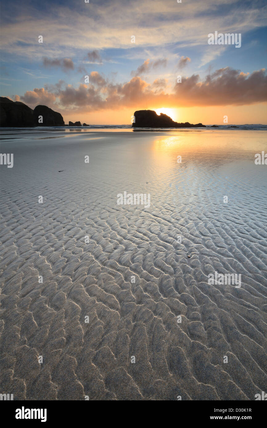 Sand patterns on Perranporth beach in Cornwall, captured at sunset - Stock Image
