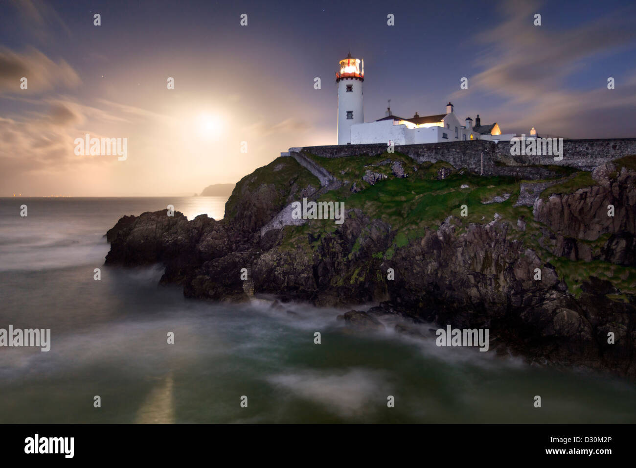 Fanad Head captured as a full moon rises behind the Lighthouse Stock Photo