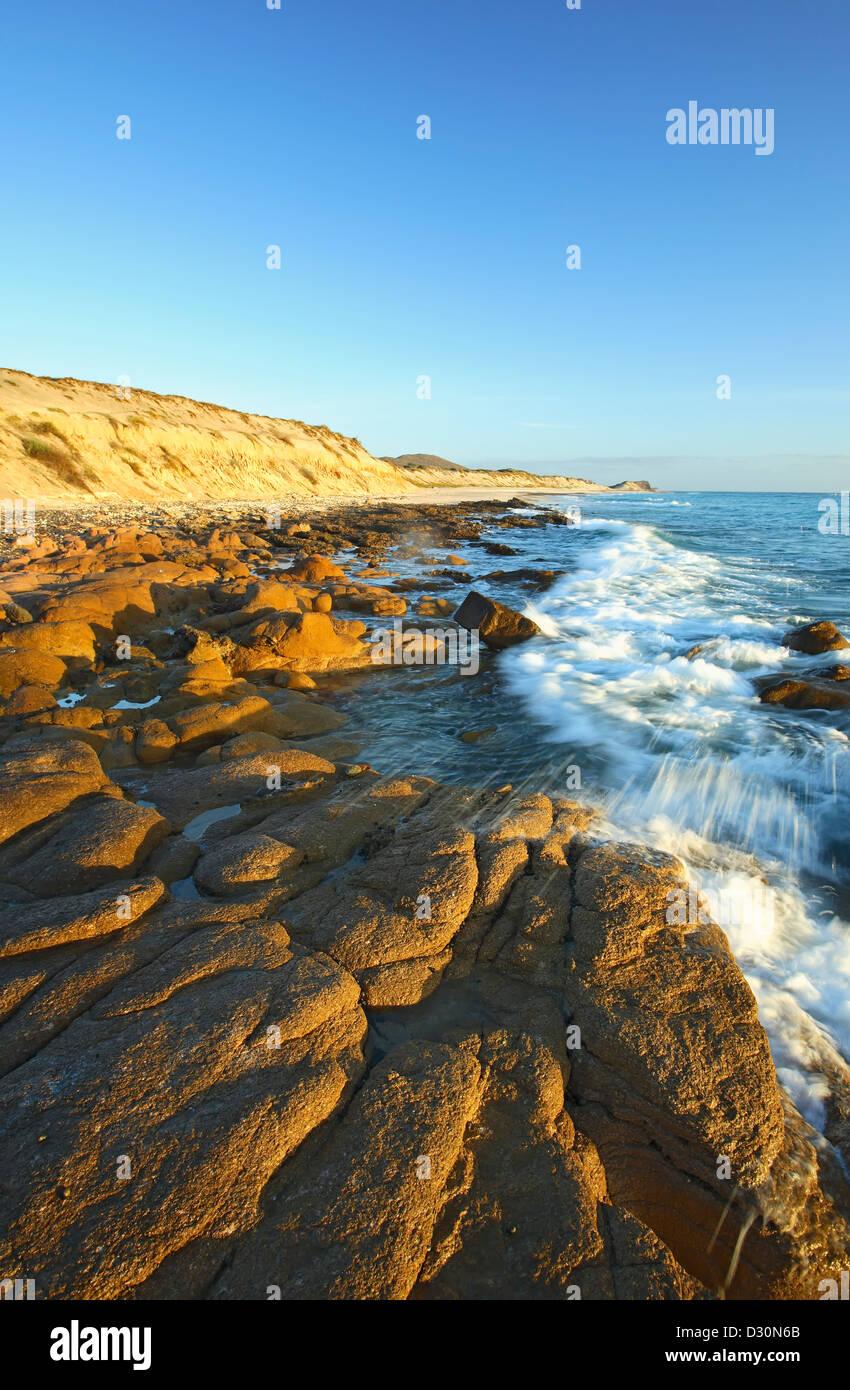 Waves crashing on rocks, Cabo Pulmo (on Sea of Cortez), Baja California Sur, Mexico - Stock Image