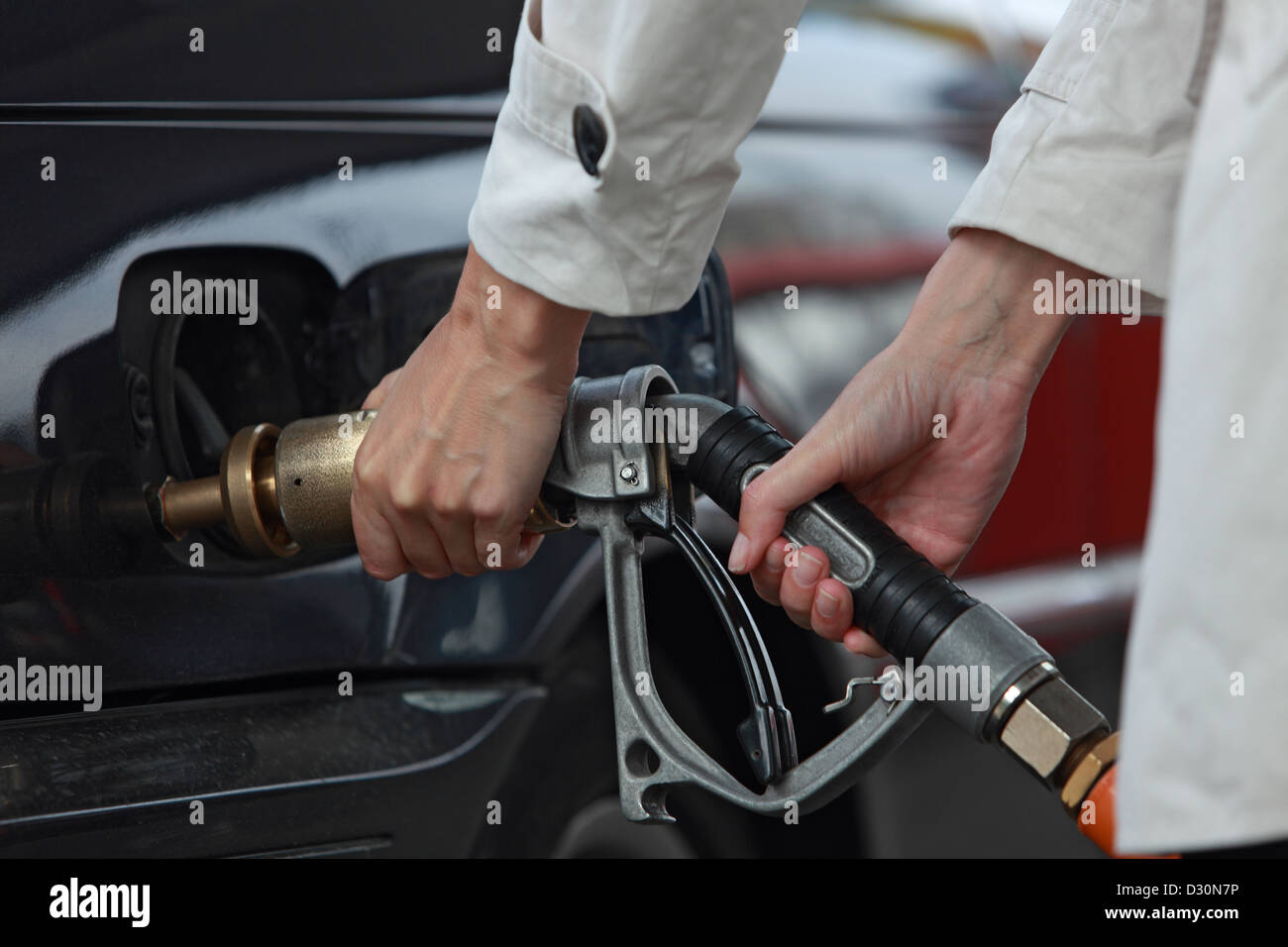 Berlin, Germany, the hands of a motorist when refueling gas - Stock Image