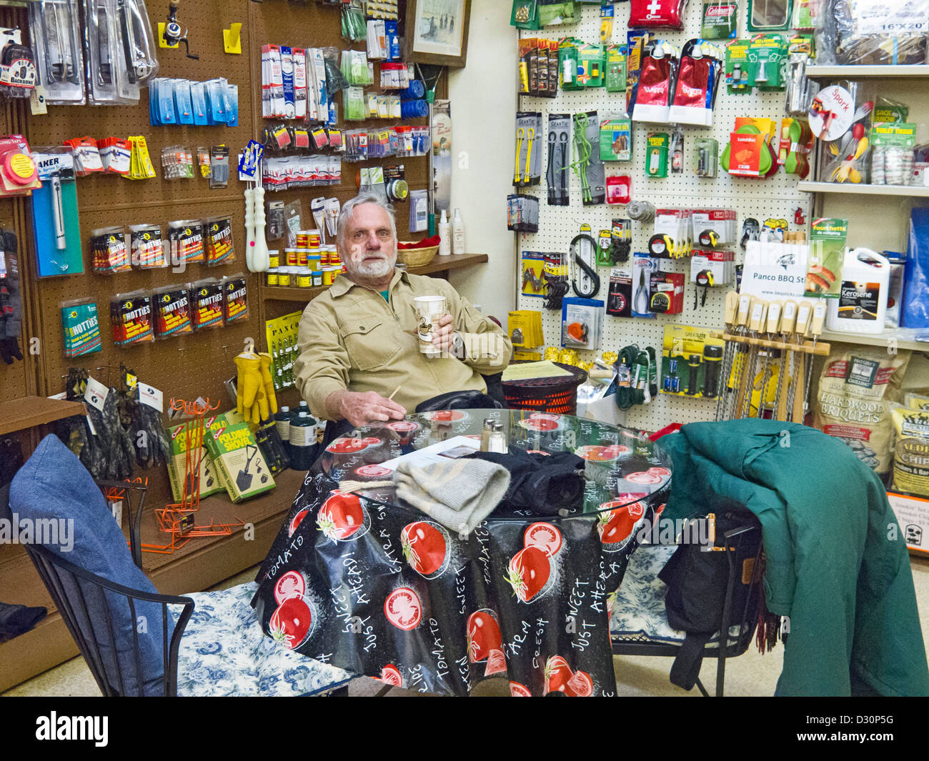 Local man sits in Beaver Mines General store, eclectic collection of stuff plus basic groceries - Stock Image