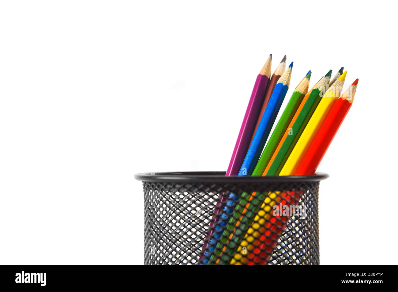 Wood color pencils in black metal pencil holder over a white background Stock Photo
