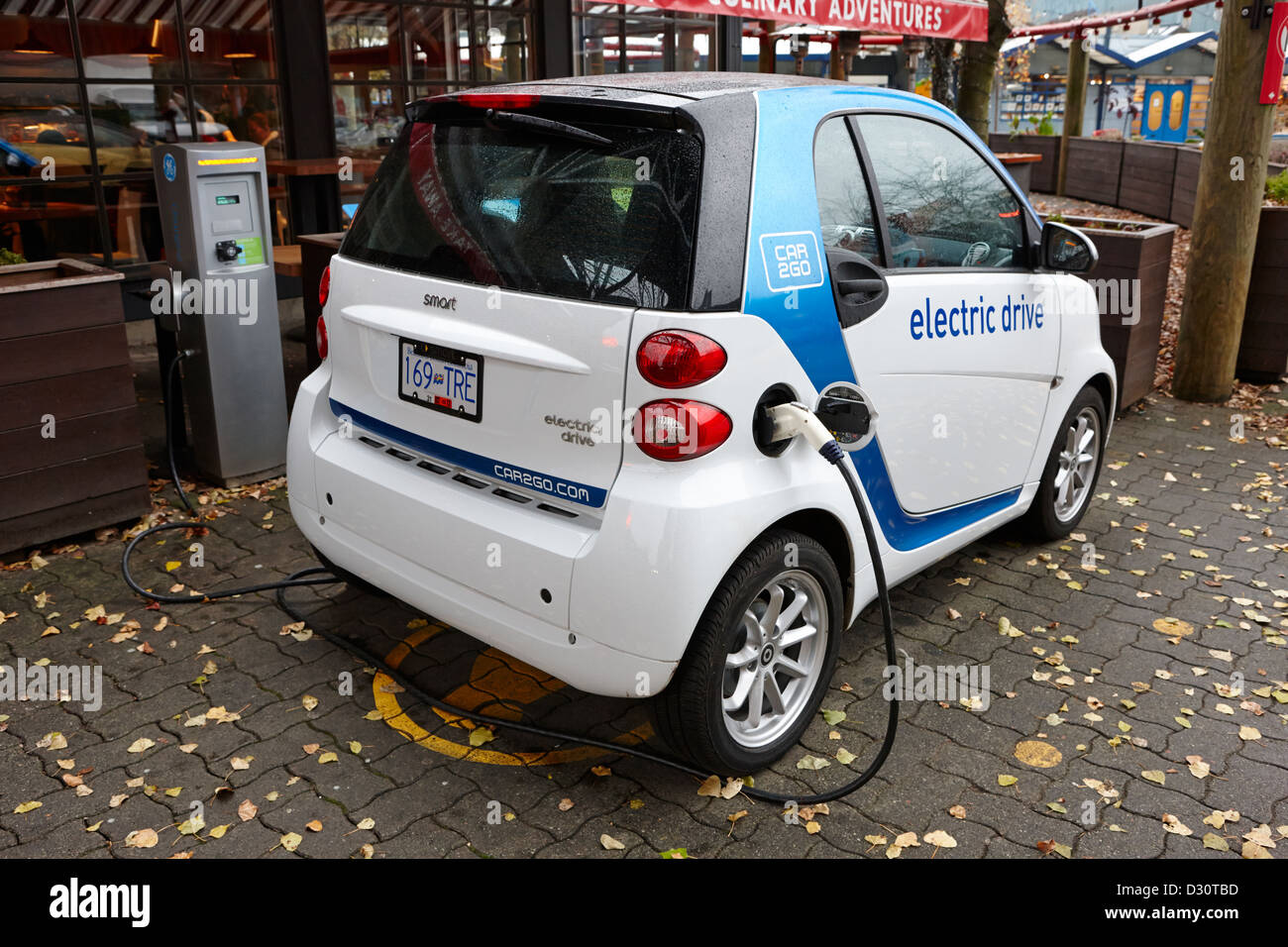 car sharing car2go electric car charging at a parking spot in Vancouver BC Canada - Stock Image