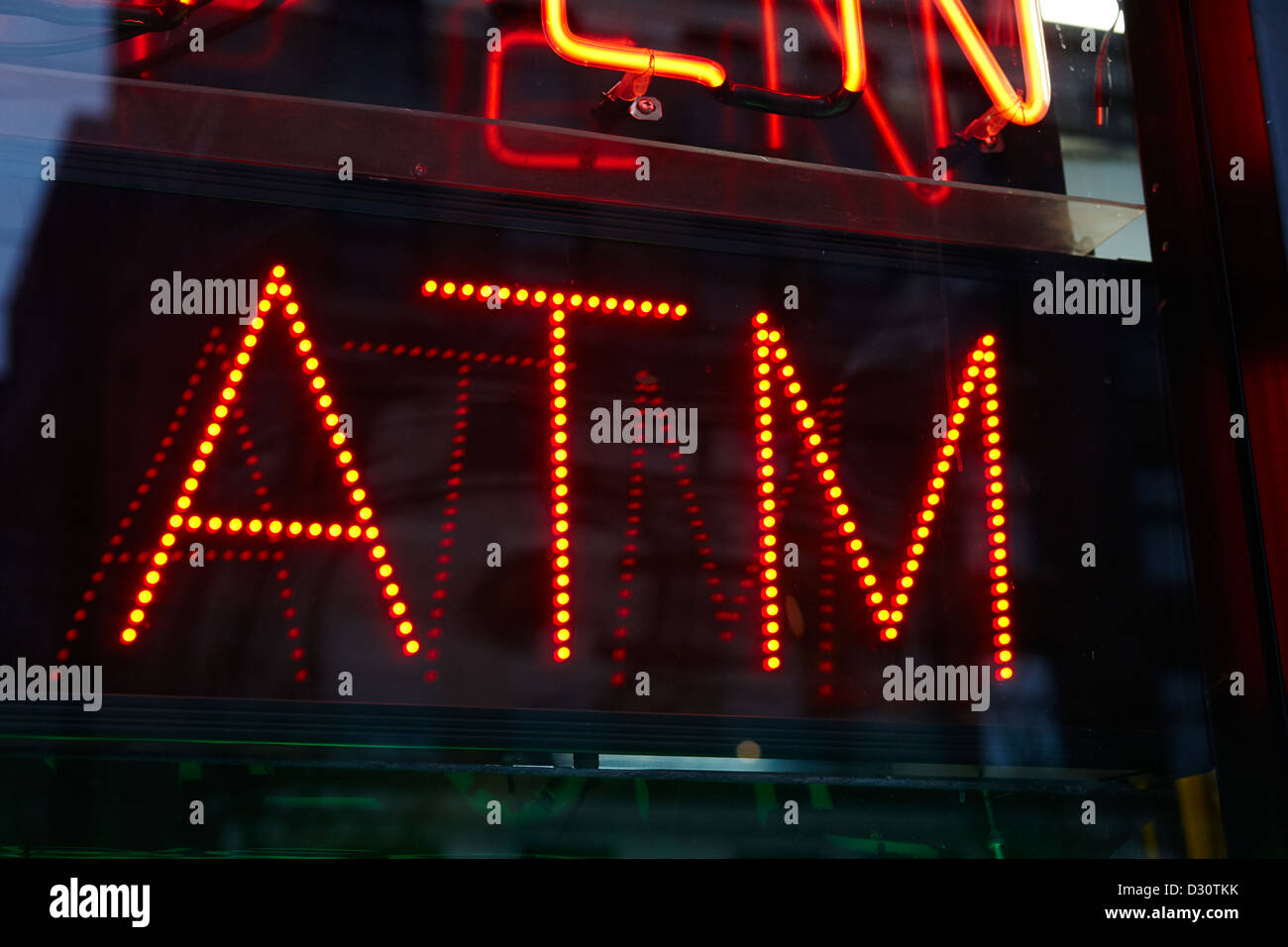 red led atm sign in the window of a store Vancouver BC Canada - Stock Image