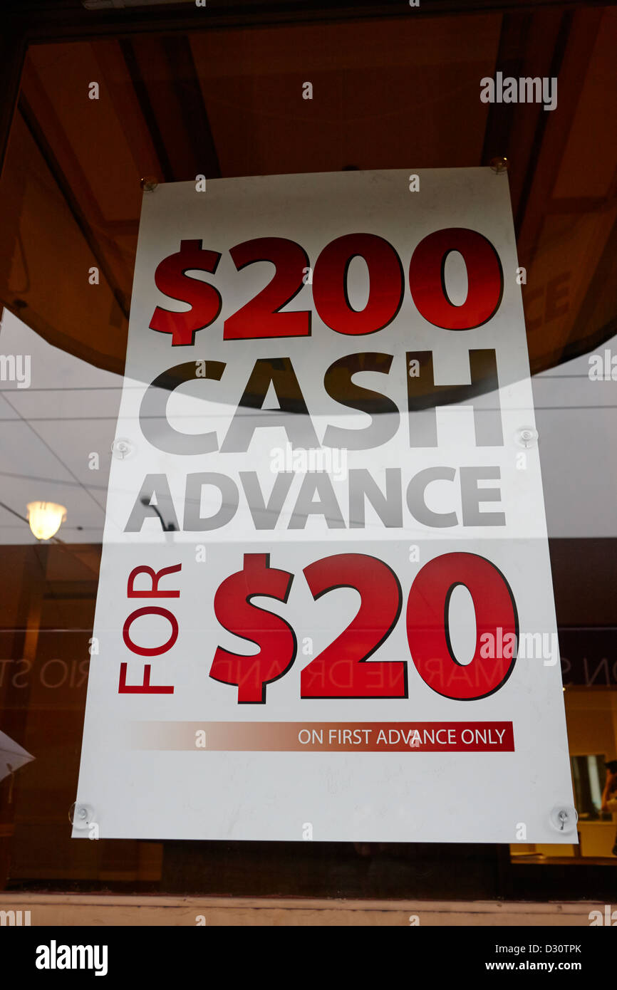 cash advance dollars sign in loan store window Vancouver BC Canada - Stock Image