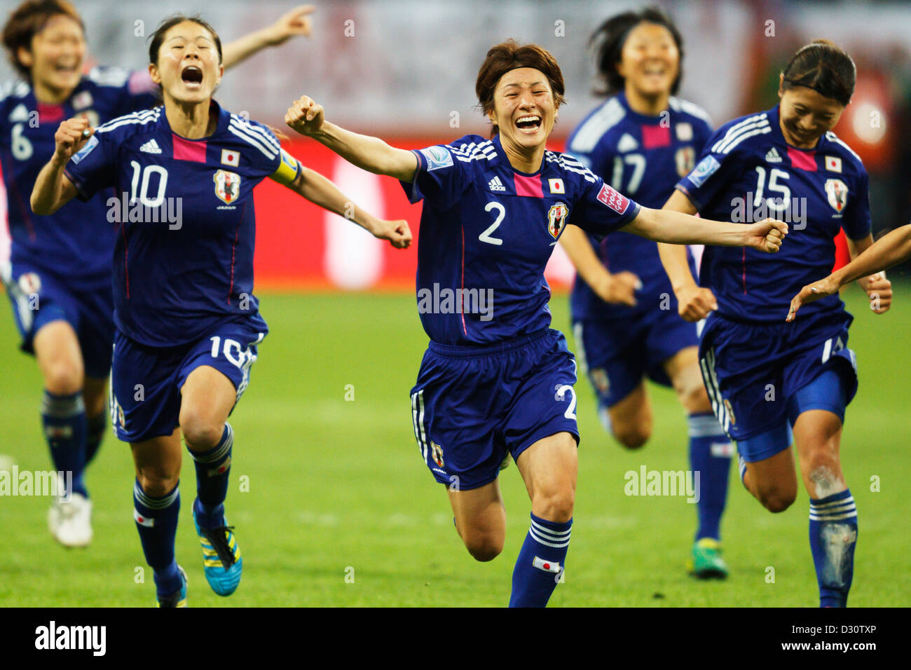 Japan team players celebrate after defeating the United States to win the FIFA Women's World Cup final. - Stock Image