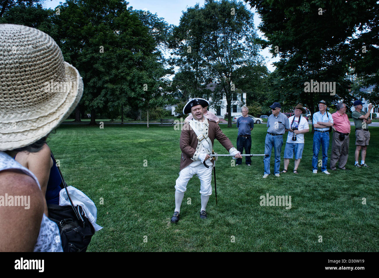 While My Guitar Gently Weeps-- Man in colonial period dress playing his cane as if it were a guitar - Stock Image