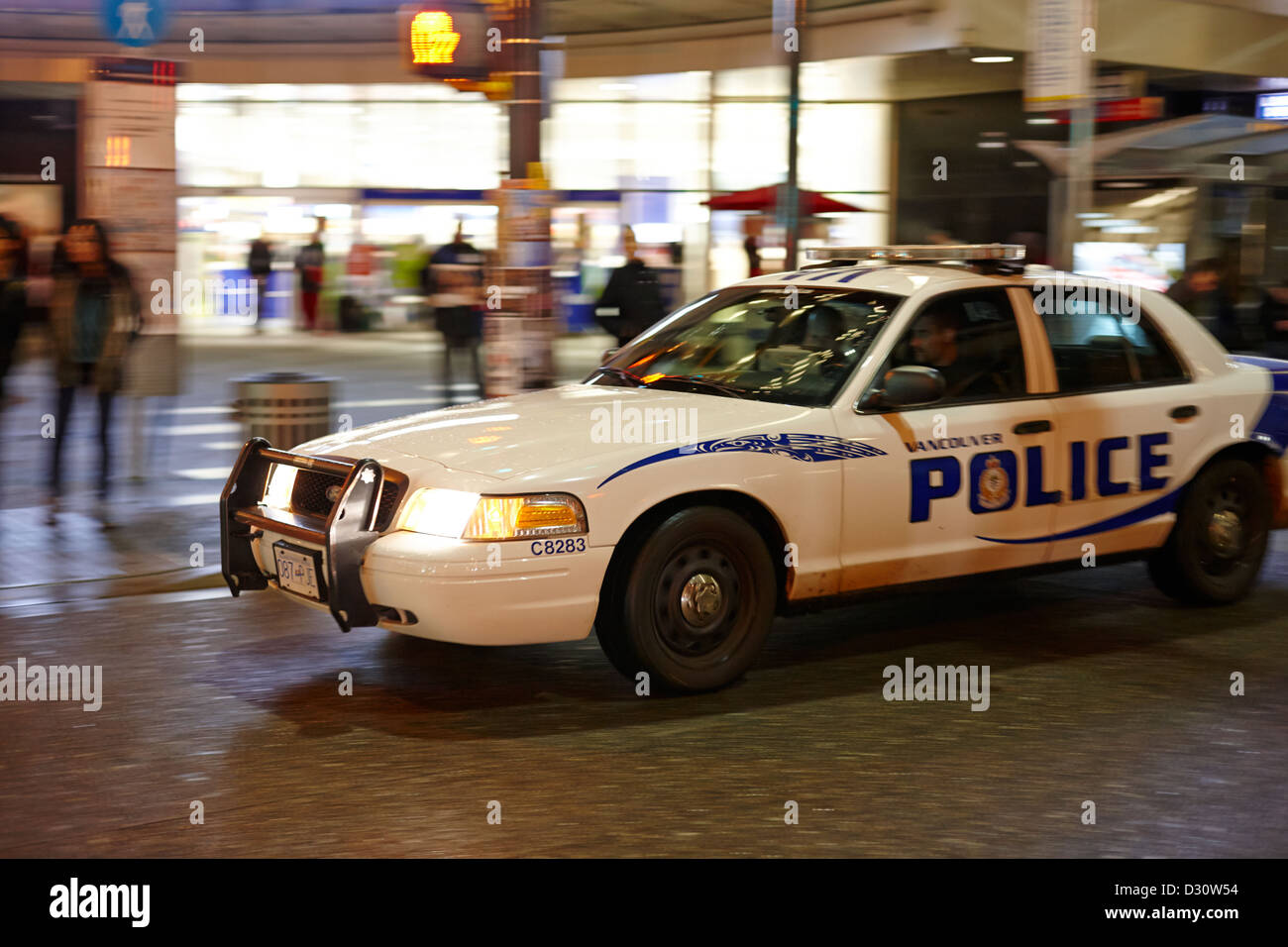 Vancouver police squad patrol car vehicle BC Canada deliberate motion blur Stock Photo