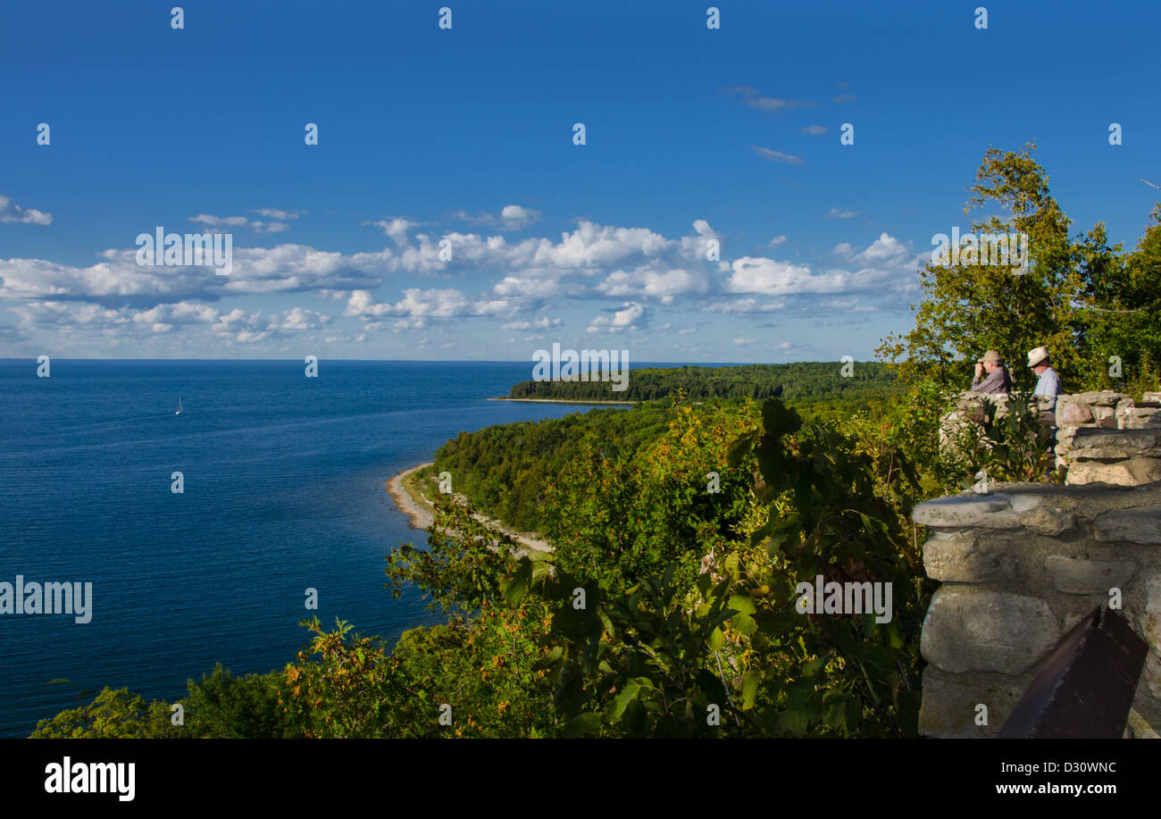 Tourists at Sven's Bluff Scenic Overlook looking at Green Bay in Peninsula State Park in Door County, Wisconsin - Stock Image
