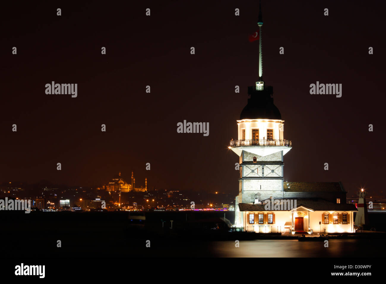 Maiden's tower floodlit at night sits on islet off the coast of Uskudar, Bosphorus strait, Istanbul Asian side, - Stock Image