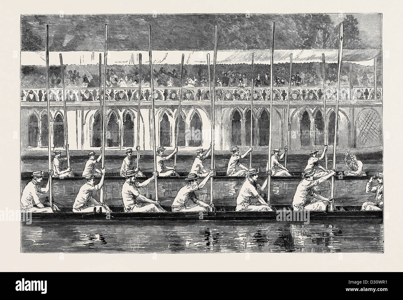 OXFORD: PROCESSION NIGHT, THE BOATS SALUTING THE 'HEAD OF THE RIVER' IN FRONT OF THE 'VARSITY BARGE - Stock Image