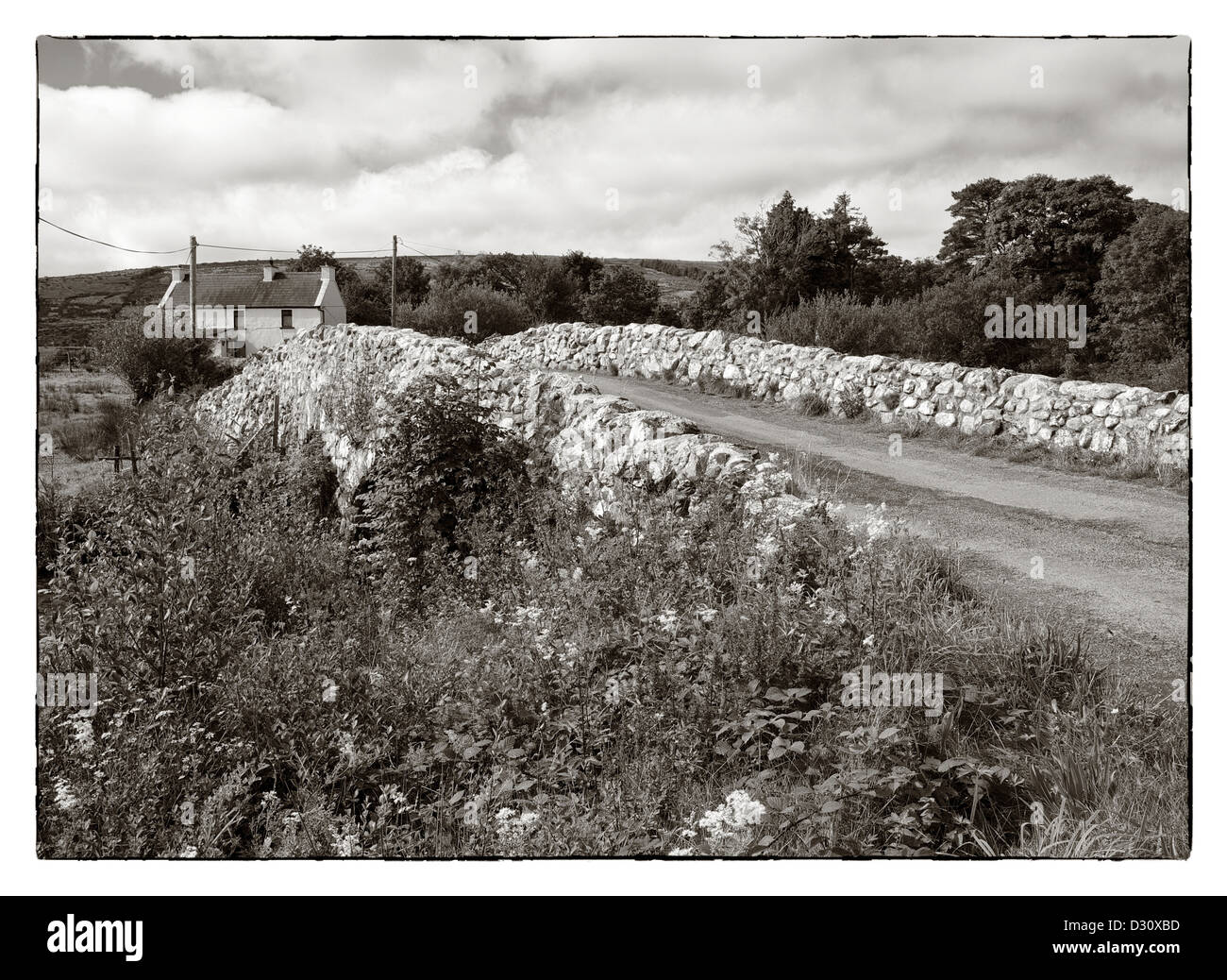 The Quiet Man Bridge in County Galway, Ireland. The historic stone bridge featured in the 1950s film, 'The Quiet - Stock Image