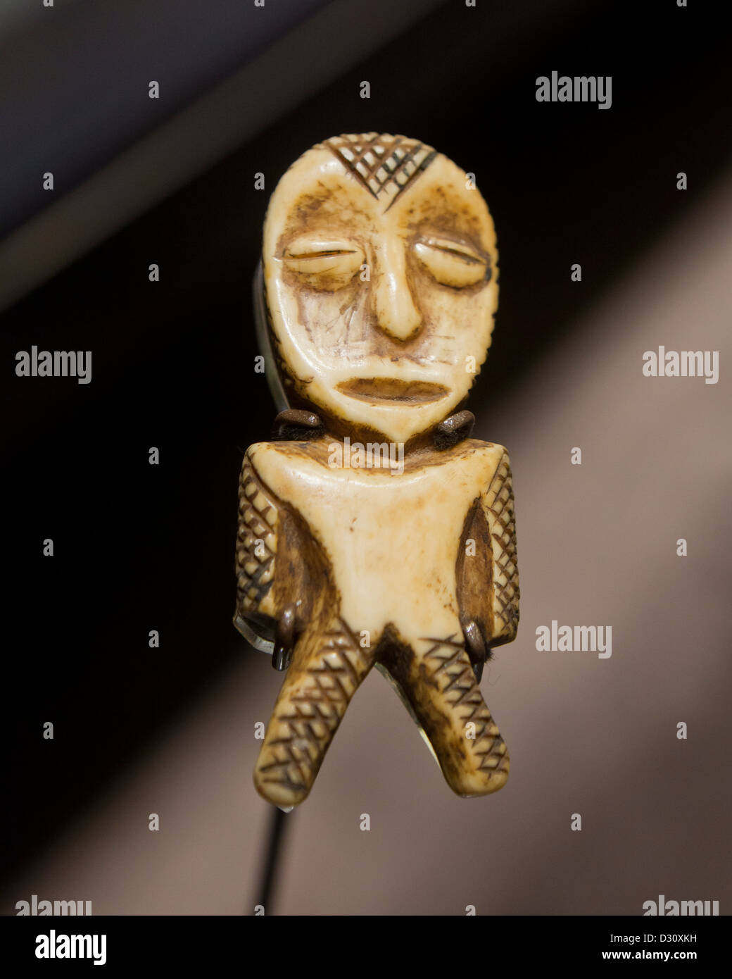 Carved ivory figure from Congo - Stock Image